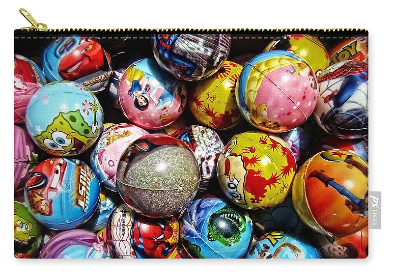 Toys Carry-all Pouch featuring the photograph Toy Balls by Alice Gipson