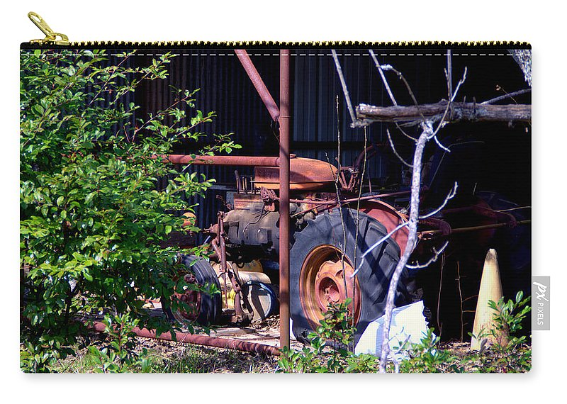 Tractor Carry-all Pouch featuring the photograph Tractor In Shed by Darrell Clakley