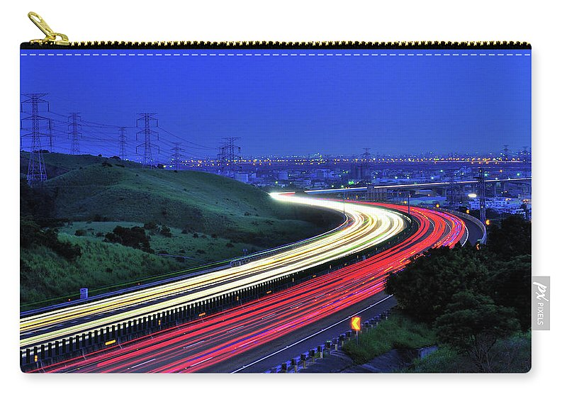 Curve Carry-all Pouch featuring the photograph Traffic Trails At High Way by Photo By Vincent Ting