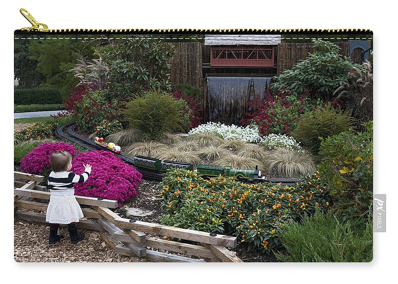 Outdoor Miniature Train Display Carry-all Pouch featuring the photograph Train Garden And Girl by Sally Weigand