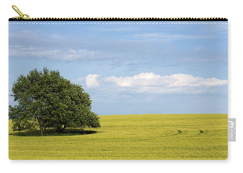 Grass Family Carry-all Pouch featuring the photograph Trees In Wheat Field by Simplycreativephotography