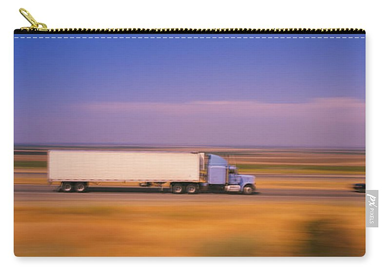 Photography Carry-all Pouch featuring the photograph Truck And A Car Moving On A Highway by Panoramic Images