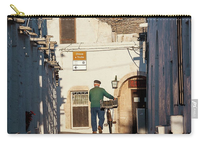 People Carry-all Pouch featuring the photograph Trulli Houses Alberobello Apulia Puglia by Peter Adams