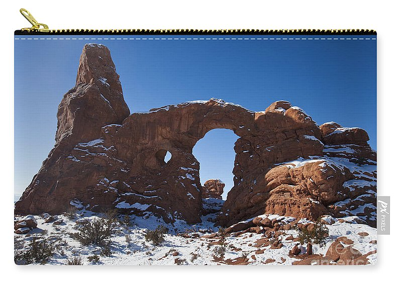 Arches Carry-all Pouch featuring the photograph Turret Arch With Snow Arches National Park Utah by Jason O Watson