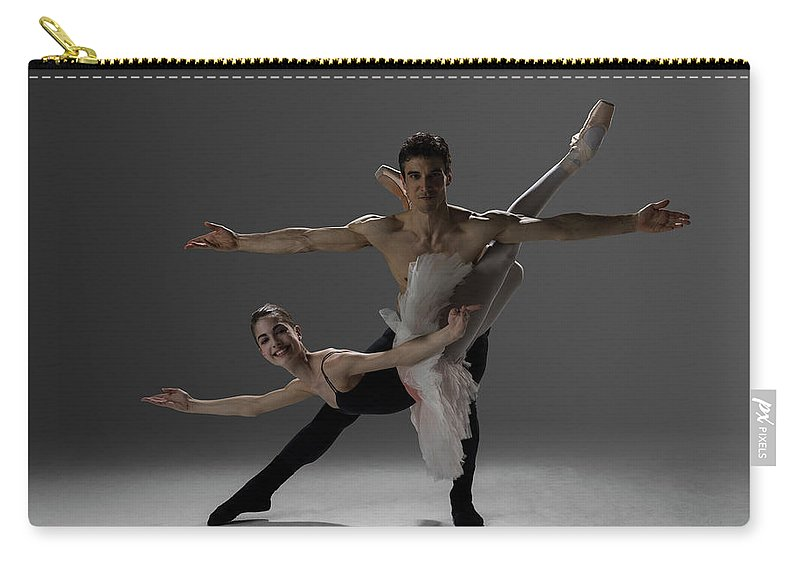 Ballet Dancer Carry-all Pouch featuring the photograph Two Ballet Dancers Performing Pas De by Nisian Hughes