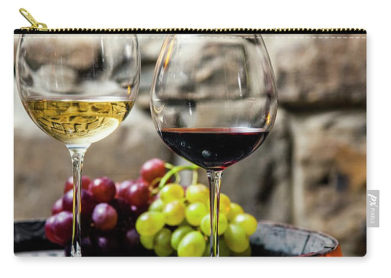 Alcohol Carry-all Pouch featuring the photograph Two Glasses Of Red And White Wine In by Piranka