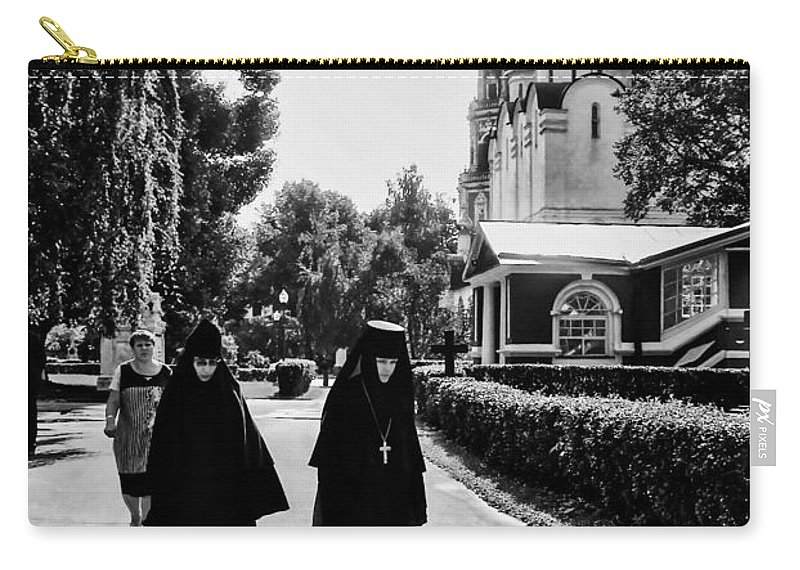 Moscow Carry-all Pouch featuring the photograph Two Nuns- Black And White - Novodevichy Convent - Russia by Madeline Ellis