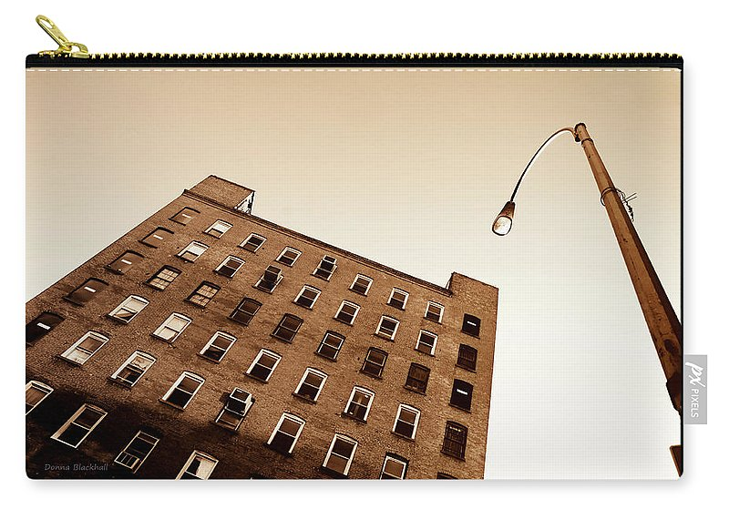 New York Carry-all Pouch featuring the photograph Under The Street Lamp by Donna Blackhall