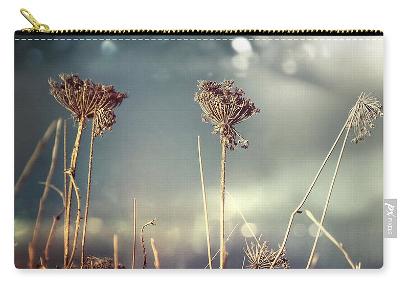Rag Carry-all Pouch featuring the photograph Unloved Flowers by Istvan Kadar