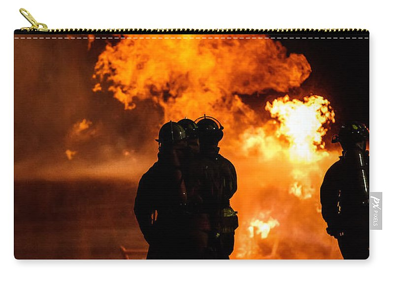Extinguish Carry-all Pouch featuring the photograph Up Close And Personal by Sennie Pierson