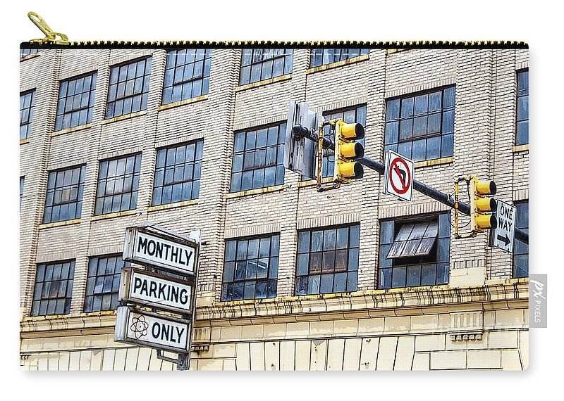 Information Medium Carry-all Pouch featuring the photograph Urban Garage Monthly Parking Only by Janice Pariza