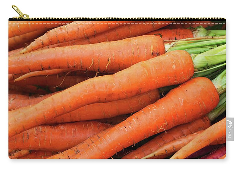 Orange Color Carry-all Pouch featuring the photograph Usa, New York City, Fresh Carrots by Tetra Images