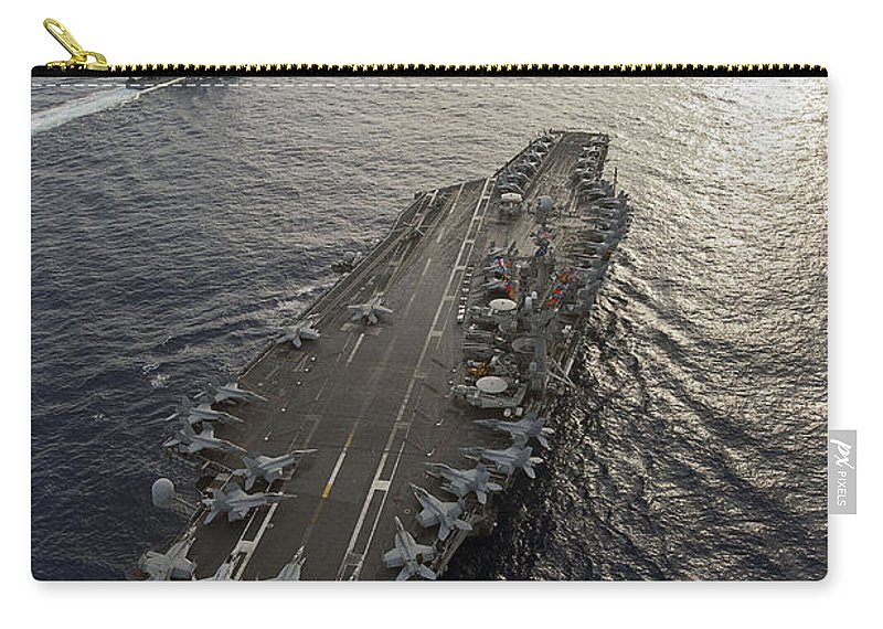 Uss George Washington Carry-all Pouch featuring the photograph Uss George Washington And Uss Mobile by Stocktrek Images