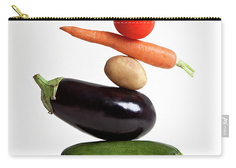 Shadow Carry-all Pouch featuring the photograph Vegetables Arranged In A Stack by Halfdark