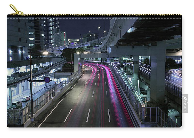 Yokohama Carry-all Pouch featuring the photograph Vehicle Light Trails On National Route 1 by Digipub