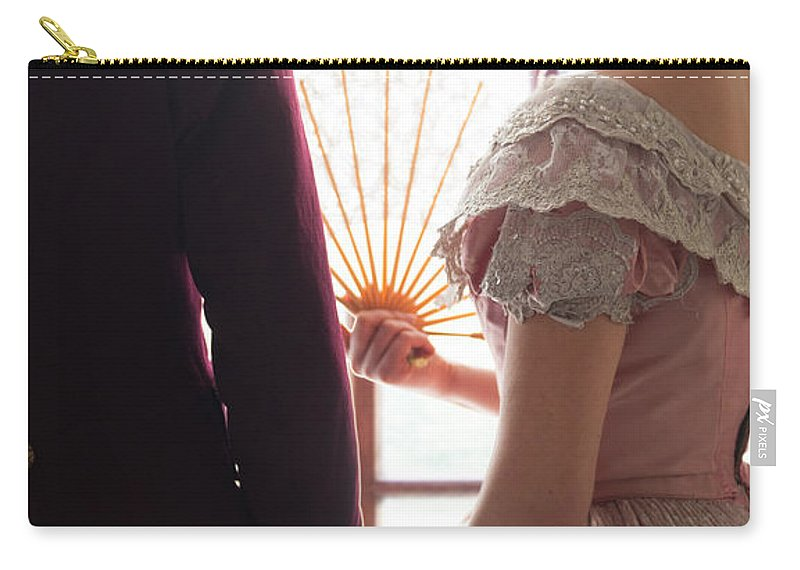Victorian Carry-all Pouch featuring the photograph Victorian Couple Looking Out Of A Window by Lee Avison