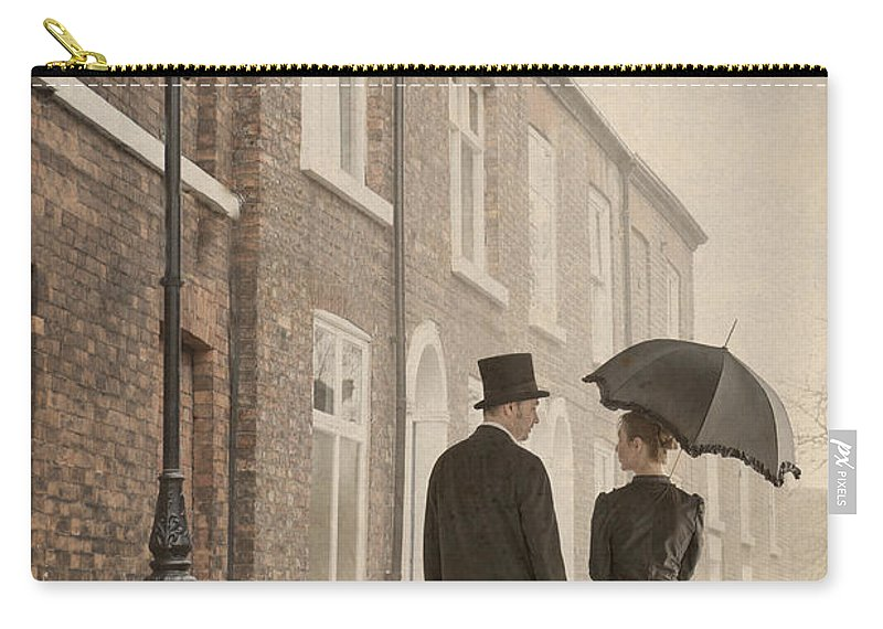 Victorian Carry-all Pouch featuring the photograph Victorian Couple On A Cobbled Street by Lee Avison