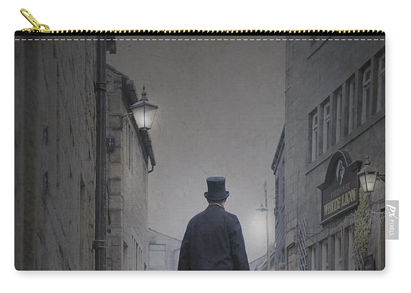 Man Carry-all Pouch featuring the photograph Victorian Man In Top Hat On A Cobbled Road At Night by Lee Avison