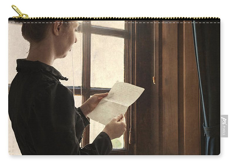 Woman Carry-all Pouch featuring the photograph Victorian Or Edwardian Woman Reading A Letter By The Window by Lee Avison