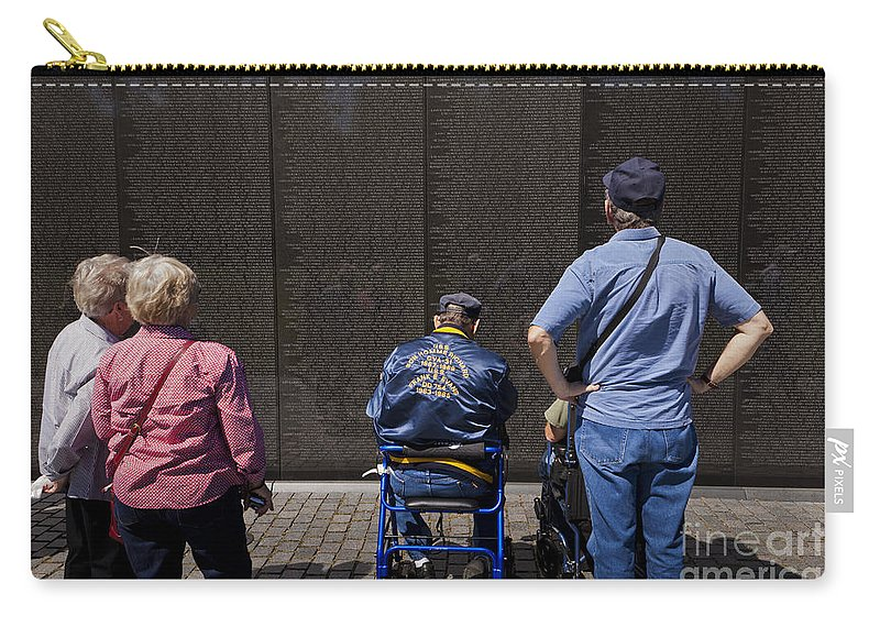 Memorial Carry-all Pouch featuring the photograph Vietnam Veterans Paying Respect To Fallen Soldiers At The Vietnam War Memorial by B Christopher