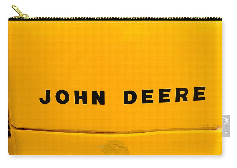 Paul Ward Carry-all Pouch featuring the photograph Vintage 1952 John Deere Tractor In Yellow by Paul Ward