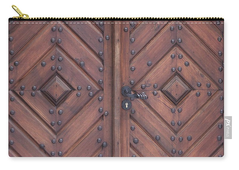 Material Carry-all Pouch featuring the photograph Vintage Wooden Brown Door Close-up by Bogdan Khmelnytskyi