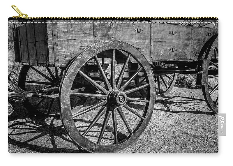 Horizontal Carry-all Pouch featuring the photograph Wagon Wheels Rolling by Doug Long