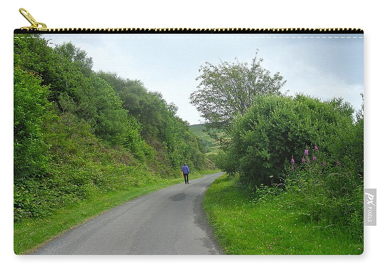 Walking A Lonely Road Carry-all Pouch featuring the photograph Walking A Lonely Road by Denise Mazzocco