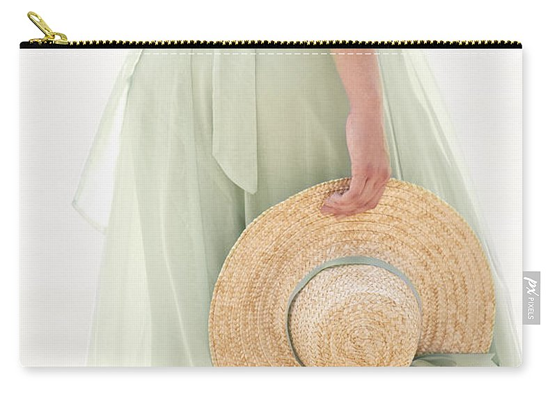 Caucasian; Female; Woman; Lady; Dress; Prairie; Hat; Arm; Body; Torso; Hand; Ribbon; Green; Spring; Summer; Pastel; Beautiful; Straw; Holding; Pretty; Delicate; Prim; Proper; Feminine Carry-all Pouch featuring the photograph Walking Along The Shore by Margie Hurwich