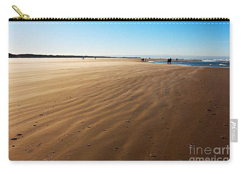 Beach Carry-all Pouch featuring the photograph Walking On Windy Beach. by Jan Brons