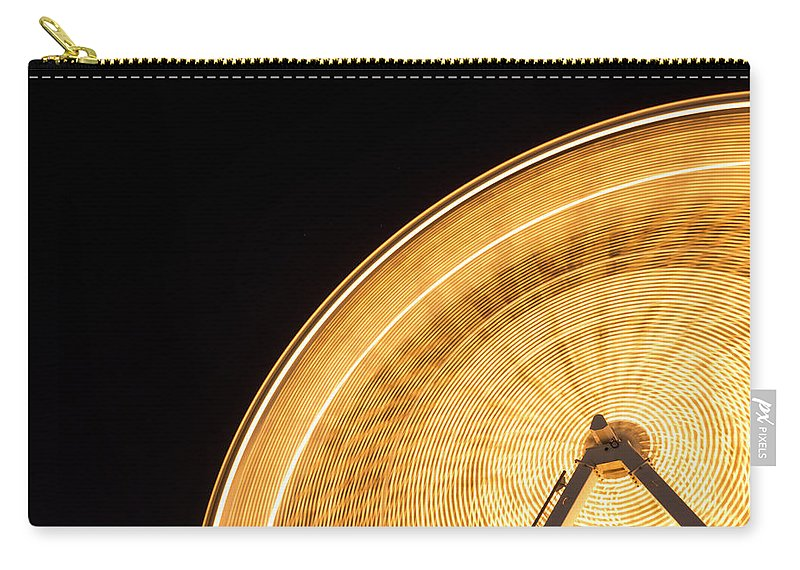 Action Carry-all Pouch featuring the photograph Watching The Wheel Go Round by Heidi Smith