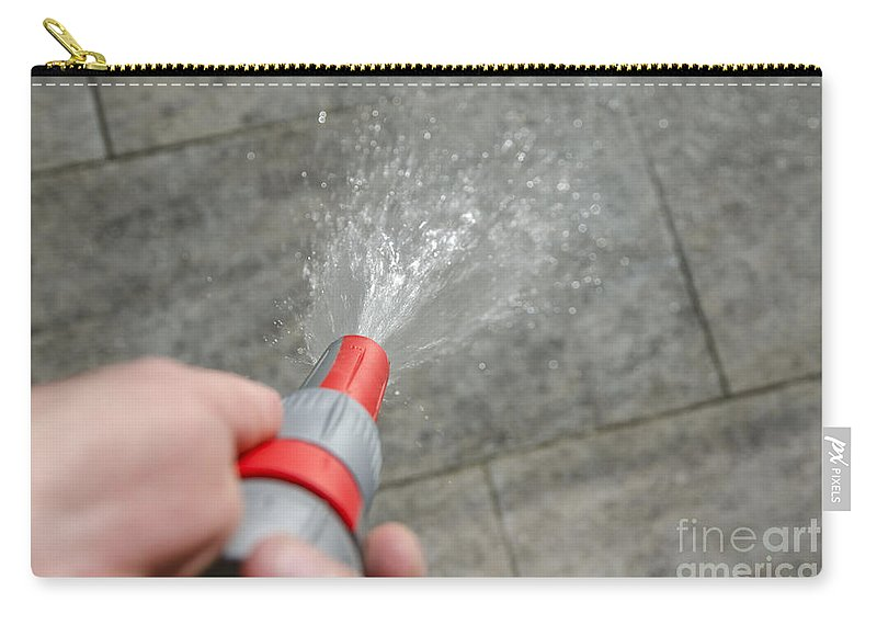 Water Hose Carry-all Pouch featuring the photograph Water Hose by Mats Silvan