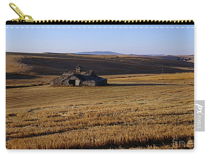 Agriculture Carry-all Pouch featuring the photograph Weathered Barn In Field by Jim Corwin