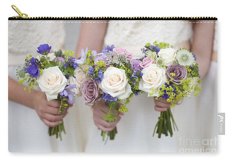 Bouquet Carry-all Pouch featuring the photograph Wedding Bouquets Held By Bridesmaids by Lee Avison