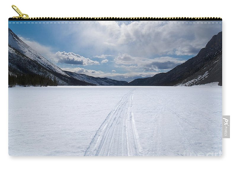Blue Carry-all Pouch featuring the photograph Well Used Winter Trail On Frozen Mountain Lake by Stephan Pietzko