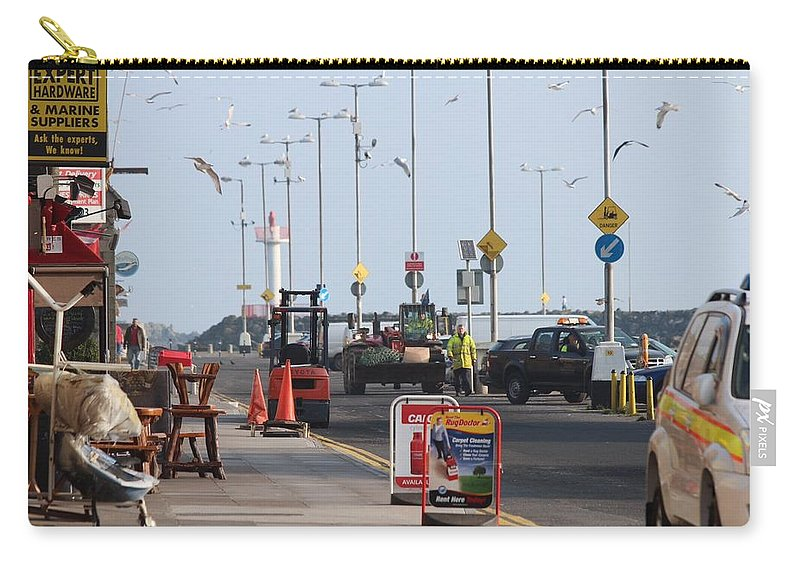 West Pier Howth Carry-all Pouch featuring the photograph West Pier Howth by Robert Phelan