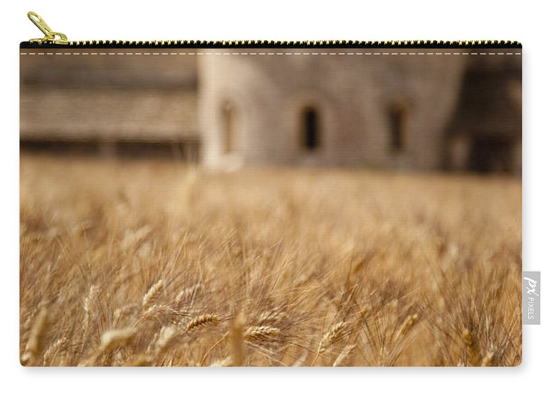 Abbaye De Senanque Carry-all Pouch featuring the photograph Wheat At The Abbaye by Brian Jannsen