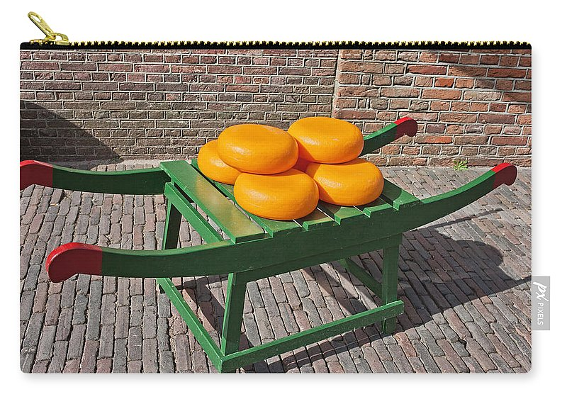 Dutch Carry-all Pouch featuring the photograph Wheels Of Dutch Gouda Cheese by Artur Bogacki