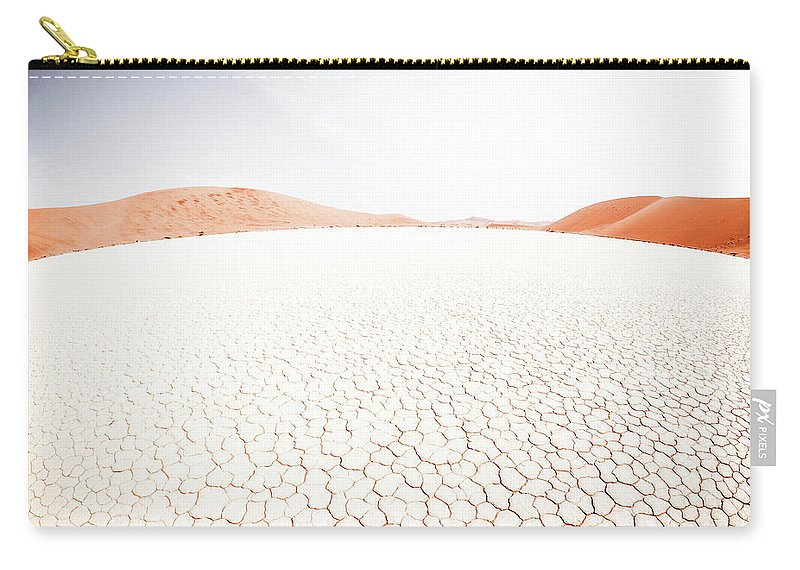 Tranquility Carry-all Pouch featuring the photograph White Clay Pan And Dunes by Taken By Chrbhm