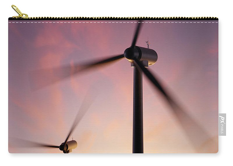Wind Carry-all Pouch featuring the photograph Wind Turbine Blades Spinning At Sunset by Johan Swanepoel