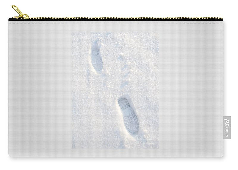 Snow Carry-all Pouch featuring the photograph Winter White Bootprints by Ann Horn