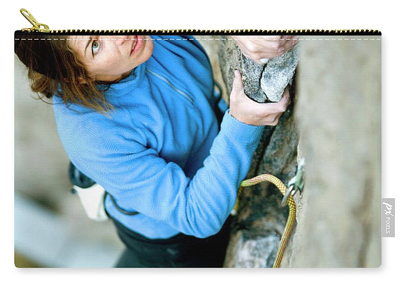 Above A River Carry-all Pouch featuring the photograph Woman Climbing Above River by Corey Rich