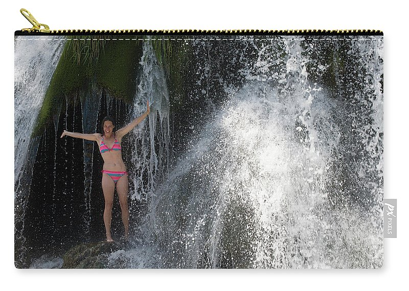 Mid Adult Carry-all Pouch featuring the photograph Woman In Bikini Standing Under Kravica by Jeanlouis Wertz