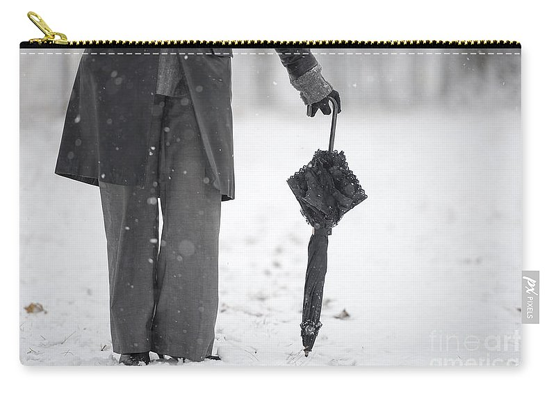 Woman Carry-all Pouch featuring the photograph Woman Leaning On An Umbrella by Mats Silvan