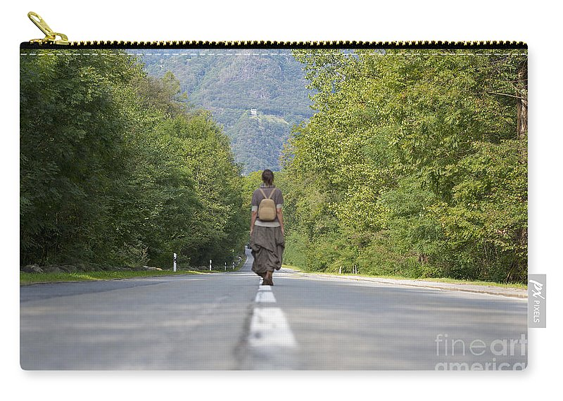 Street Carry-all Pouch featuring the photograph Woman On A Road by Mats Silvan
