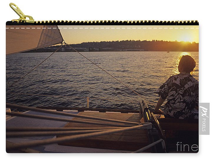 Boating Carry-all Pouch featuring the photograph Woman On Sailboat Sunset by Jim Corwin