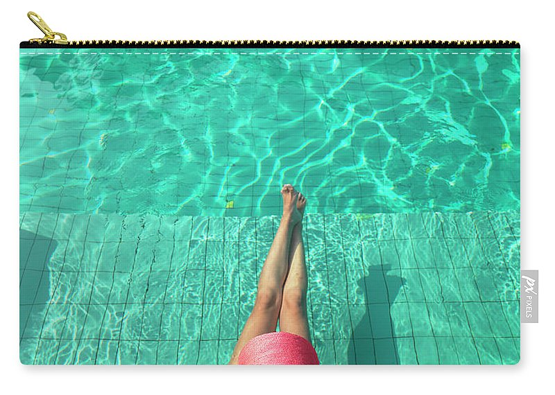 People Carry-all Pouch featuring the photograph Woman Resting At Edge Of Swimming Pool by Johner Images