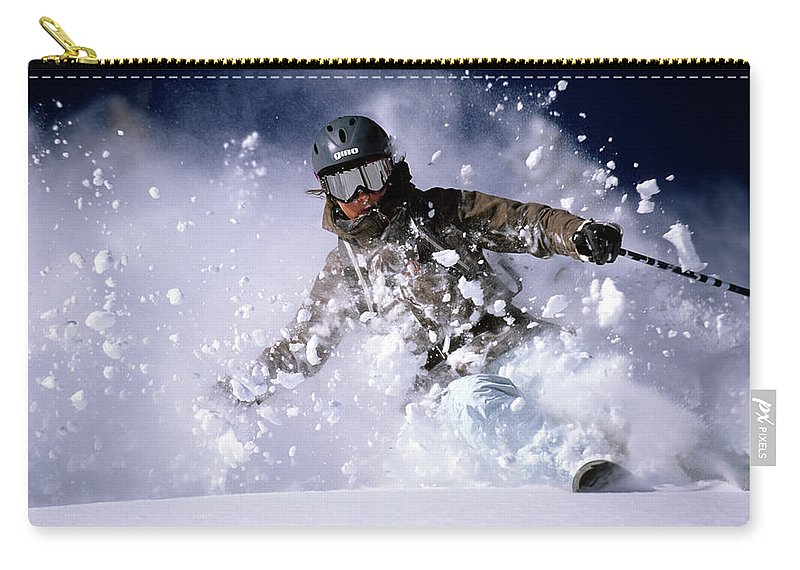 Action Carry-all Pouch featuring the photograph Woman Skiing Powder In The Wasatch by Scott Markewitz