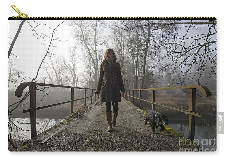 Bridge Carry-all Pouch featuring the photograph Woman Walking With Her Dog On A Bridge by Mats Silvan