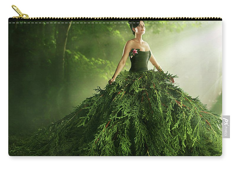 Environmental Conservation Carry-all Pouch featuring the photograph Woman Wearing A Large Green Gown In The by Paper Boat Creative